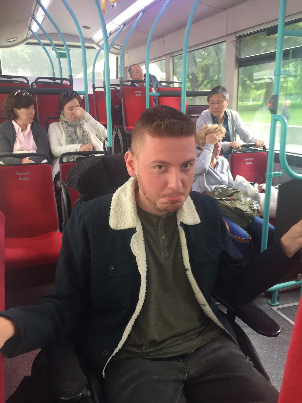 Ross pulling an unhappy face, whilst on the bus