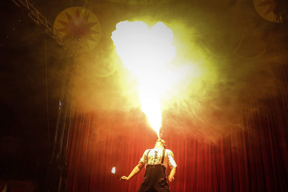 Fire breathing performer