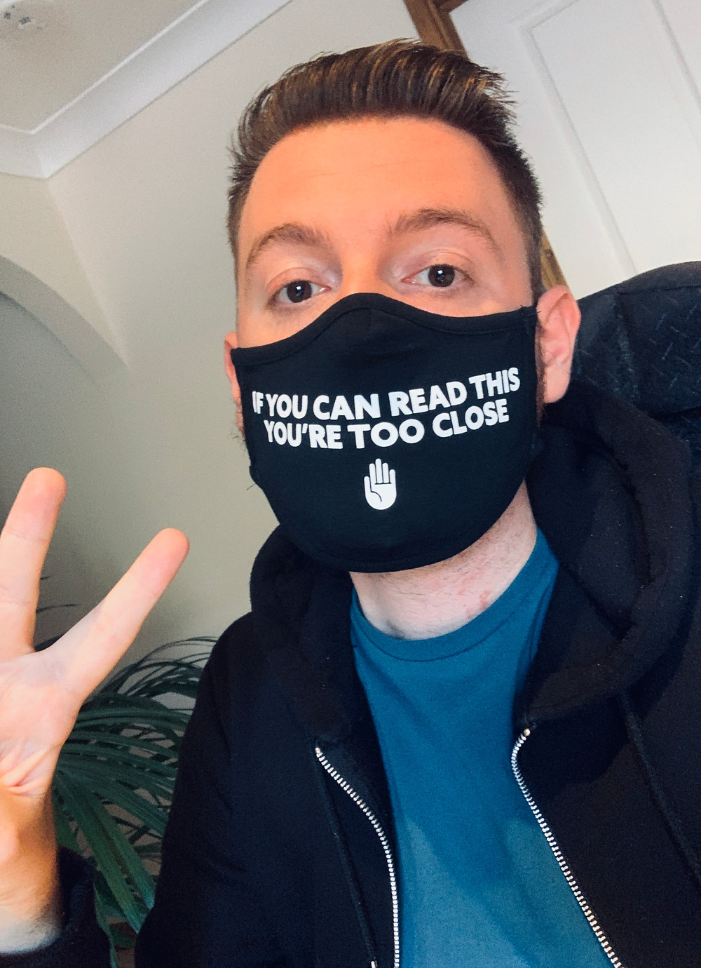 Selfie of Ross wearing a face mask with the text: If you can read this, you're too close