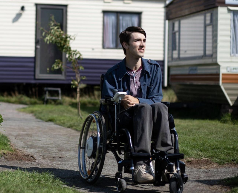 Photo os George Robinson on set as the character Isaac - wheelchair user