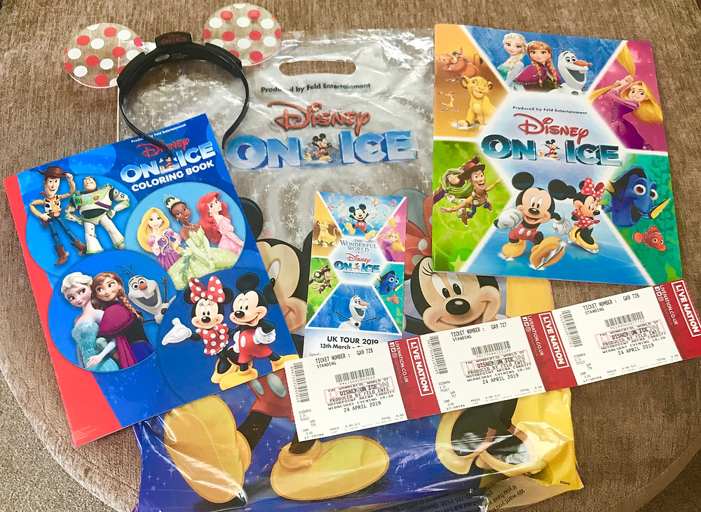 A selection of the Disney on Ice given to Ross. Including a program, light up Mickey ears, colouring book and tickets