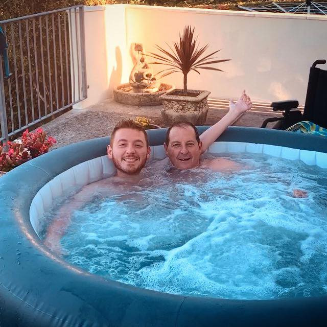 Ross and his dad, relaxing in the hot tub