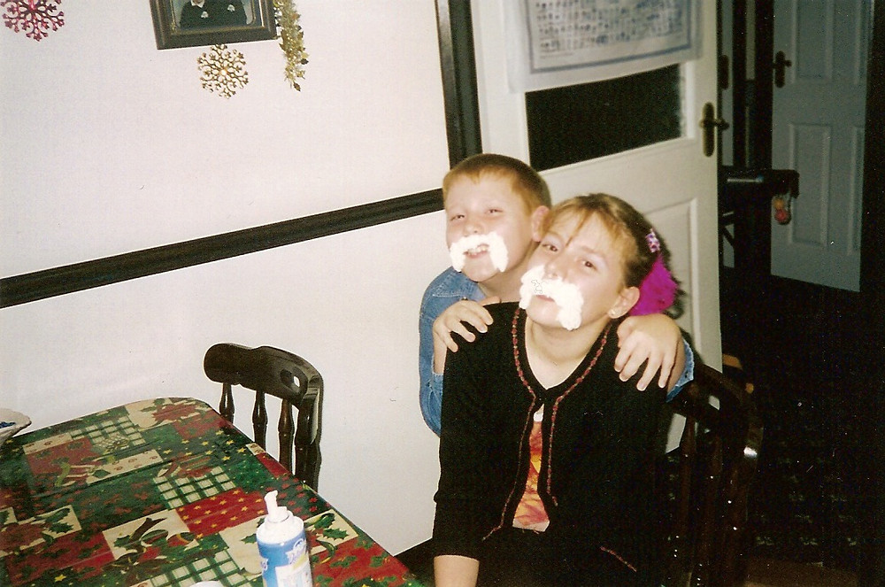 Young Ross and his sister with whipped cream moustaches