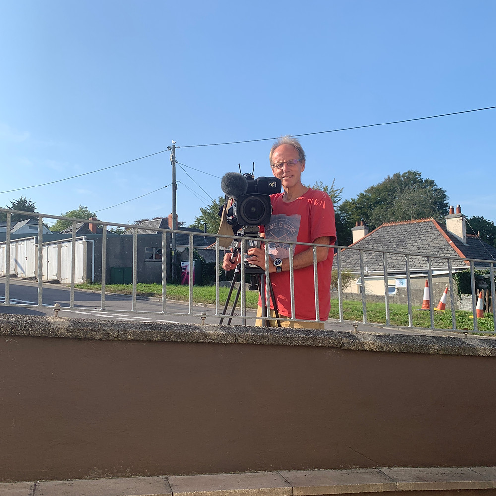 Cameraman Tony stood outside Ross's house with a large camera and tripod
