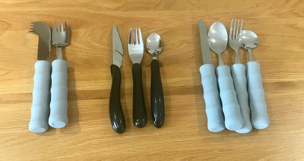 A shot of 3 separate cutlery sets