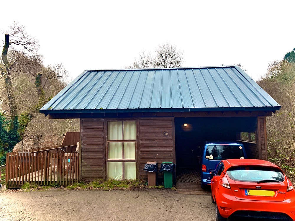 Outside view of our cabin, showing two cars parked