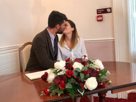 Tabs & Dom kissing after signing the marriage certificate