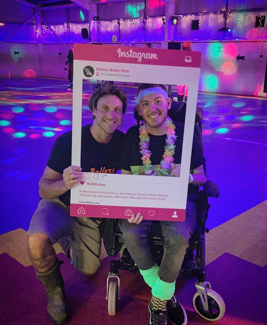 Ross and the Manager having a photo with the Rollers Instagram sign