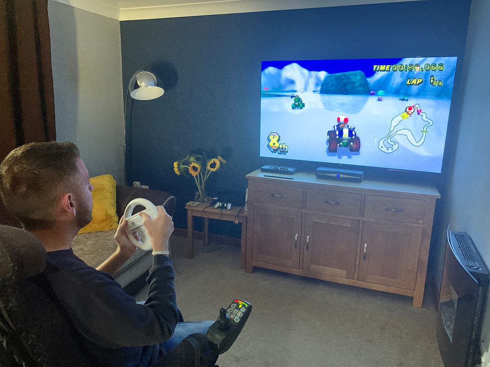 Ross playing mario kart in his living room