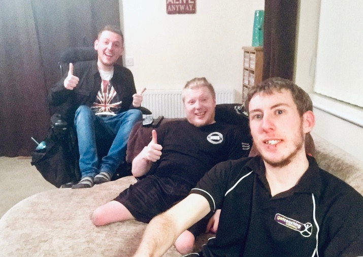 A selfie of Ross, Mark & James, sat around the sofa
