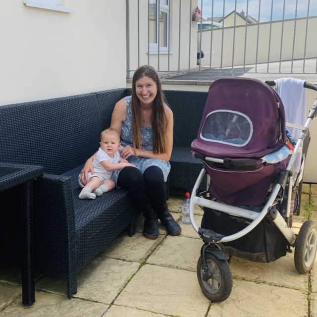 Ross's friend sat outside with her baby