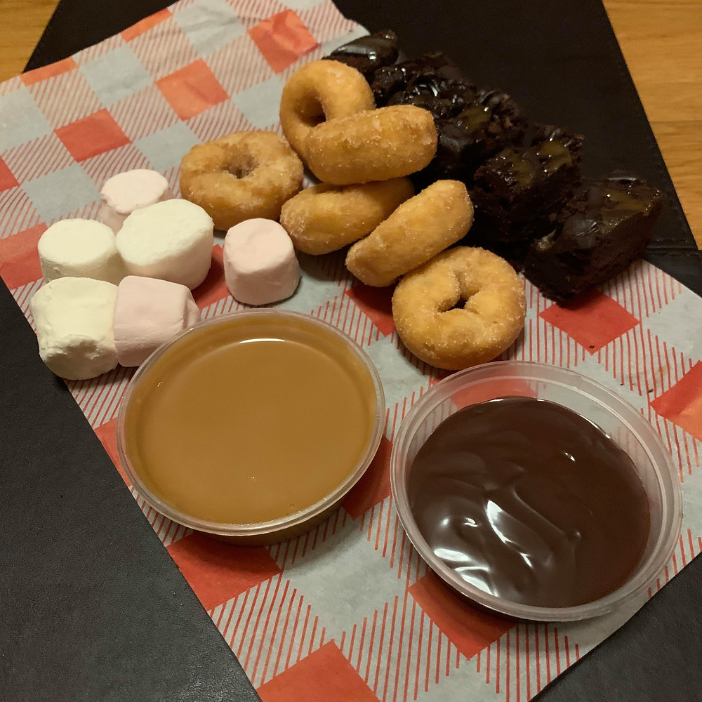 Chocolate and toffee dipping pots, with marshmallows, mini doughnuts and brownies