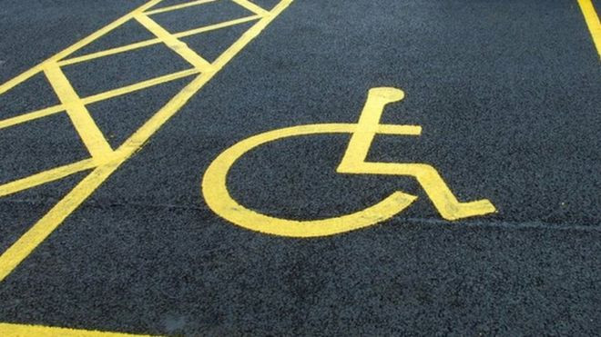 Yellow floor markings of a disabled parking bay