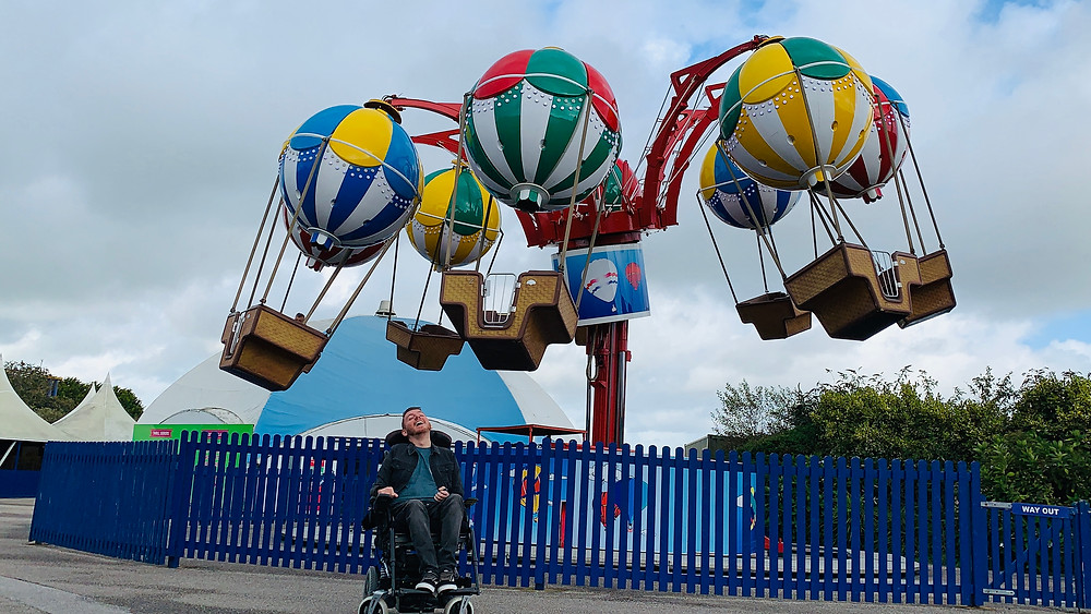 Ross sat in his wheelchair, in front of hot air balloon ride at Flambards