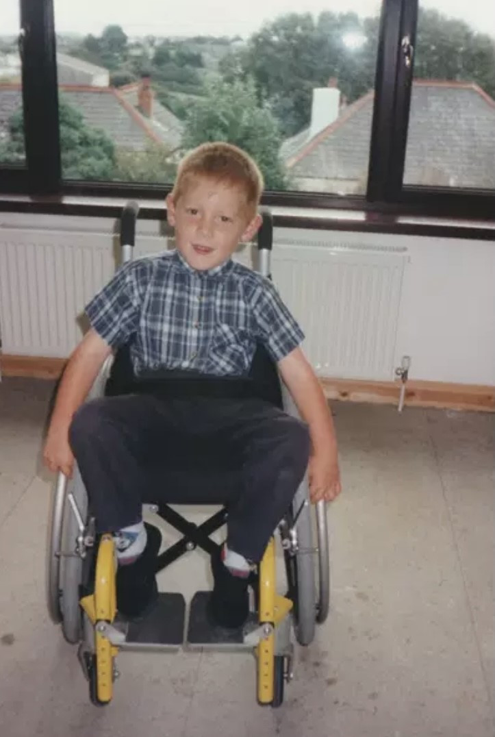 Toddler Ross sat in his yellow wheelchair