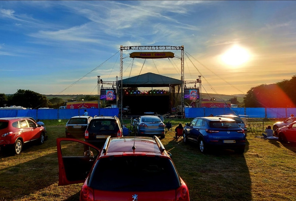 Ross' view of the stage from his vehicle, sunset in the background