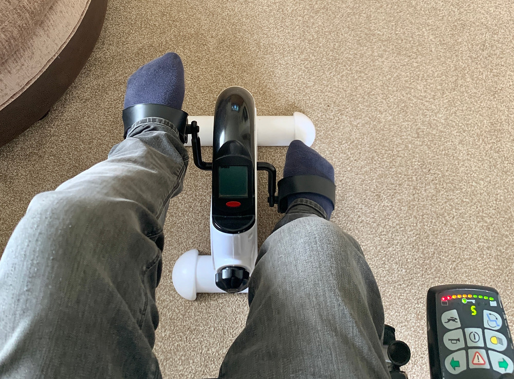 View looking down on Ross's feet on the pedal bike