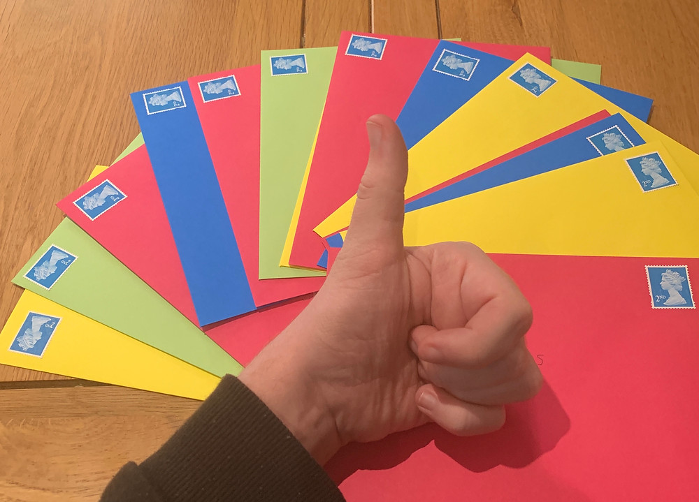 A selection of the postcards Ross's sent out. Bright coloured envelopes.