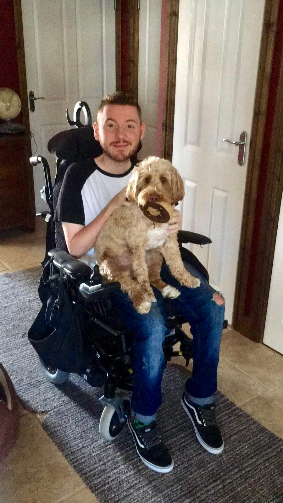 Ross sat in his wheelchair, with Ralph perched on his lap