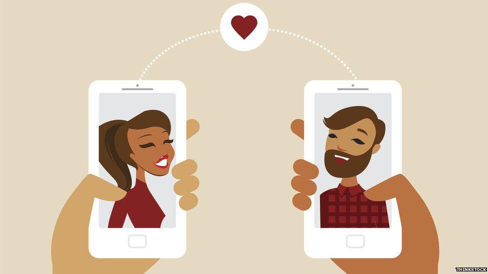 Clip art image of two people texting with a love heart