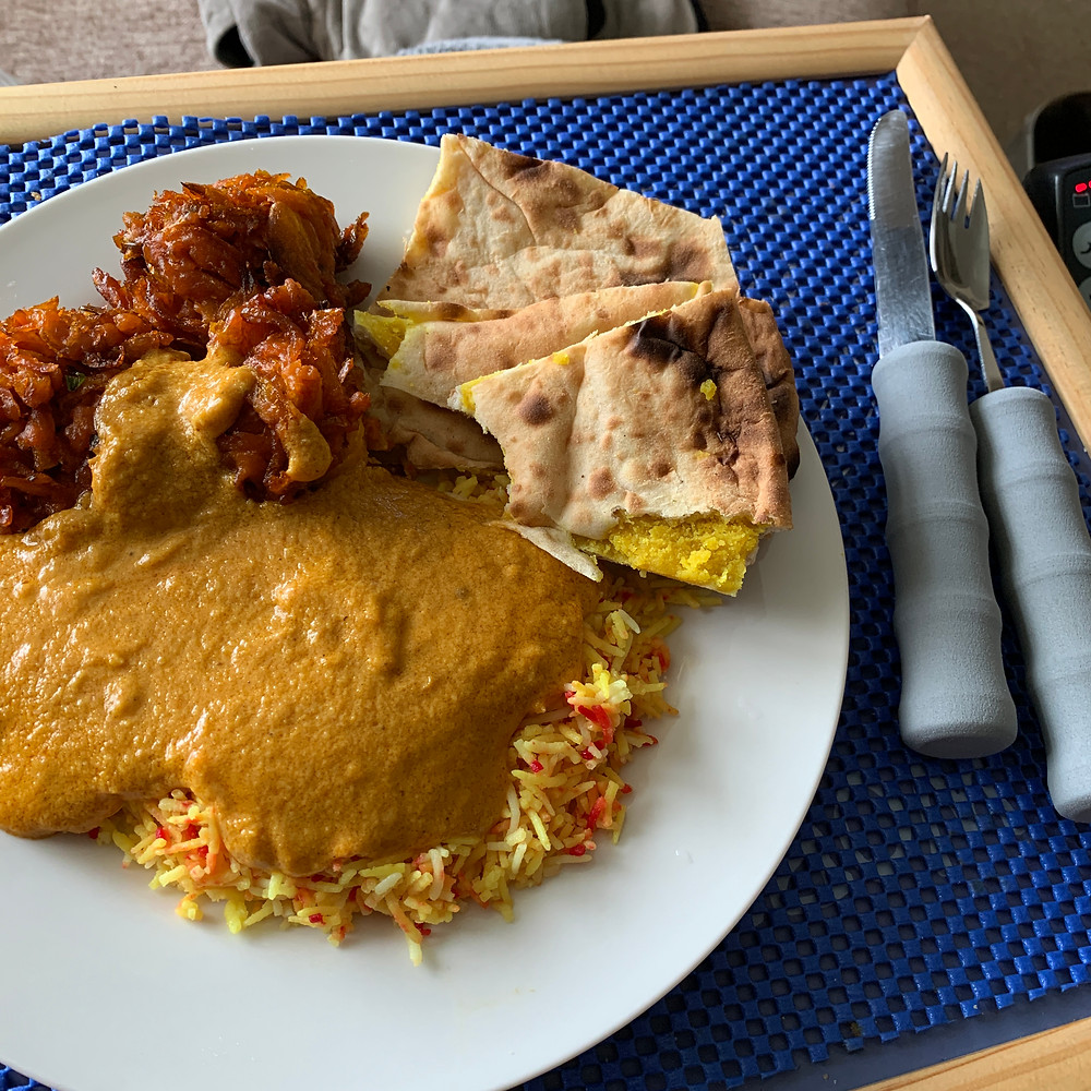 Ross's indian curry on a lap tray, with onion bahjis and naan bread