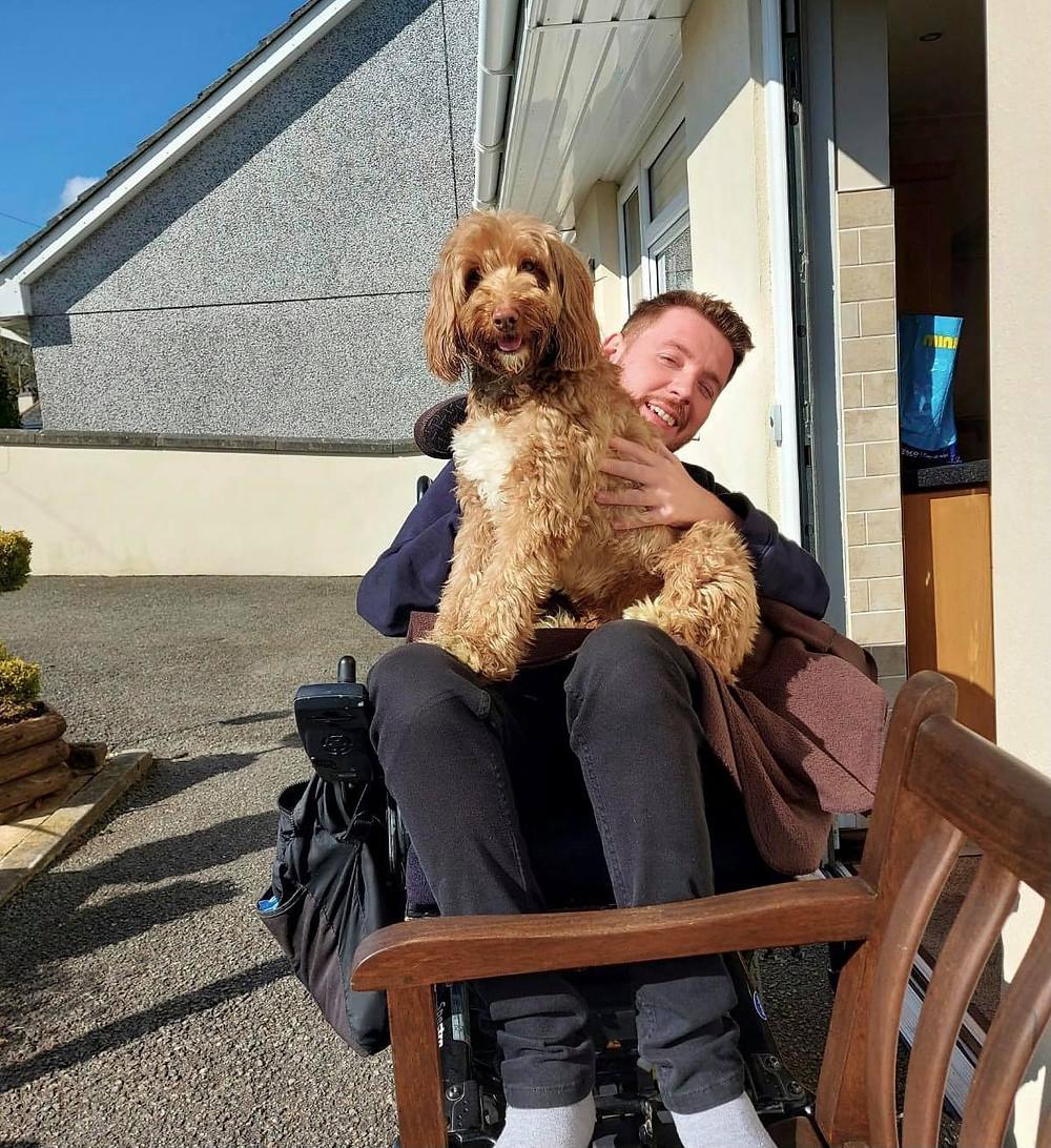 Ralph sat on Ross's lap outside in the garden