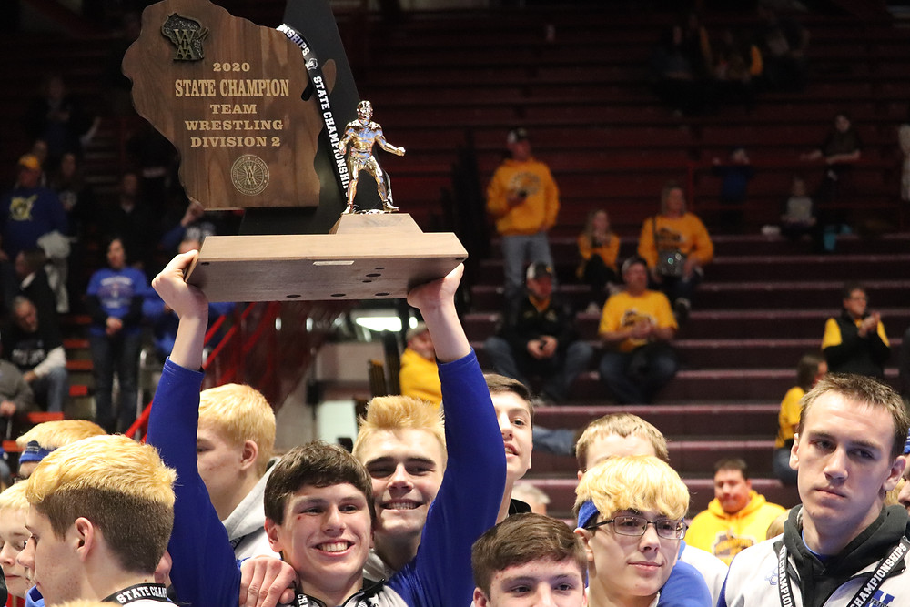 Wrightstown senior Ben Durocher celebrates with teammates after the Tigers earned the school's first Division 2 state wrestling championship on Saturday at the UW Field House in Madison, Wis. (David Nordby/Brillion News photo)