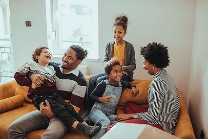 AAfamily laughing on sofa.jpeg