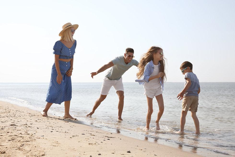 Happy family at beach on sunny summer da