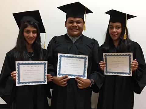 Three Graduates w: diplomas.jpeg