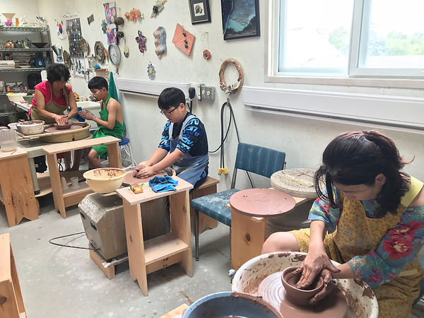 Students (children and adults) attending my pottery class