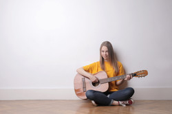 woman living room guitar
