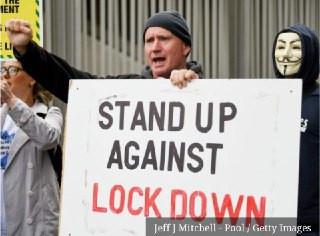 Reino Unidos: Manifestantes tomam as ruas de Manchester contra o novo lockdown.