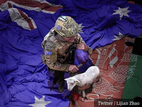 China publica imagem falsa de soldado australiano decapitando criança afegã.