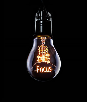 Hanging lightbulb with glowing Focus concept.jpg