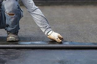 asia-worker-installing-tar-foil-rooftop-