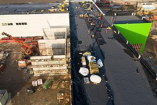 workers-make-roof-waterproofing-top-view