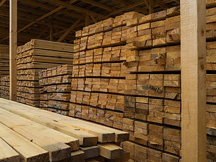 lots-planks-stacked-top-each-other-wareh