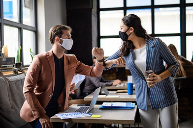 business-people-with-face-masks-greeting