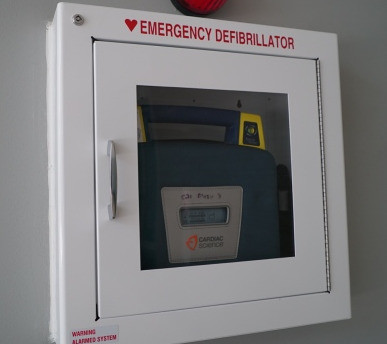 SCHOOL INACTION PROMPTS DADS INTO DEFIBRILLATOR FUNDRAISER