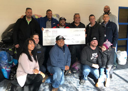Cheque for $1500  to Coats for Kids