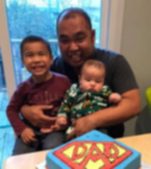 Derek Tang with his children and Superdad Cake
