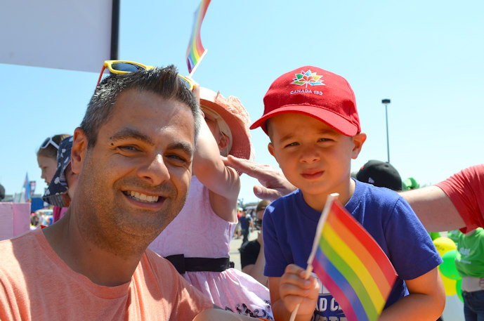 Dad and son at Gay Pride Parade