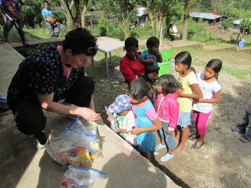 Angela Gordon handing out school supplies