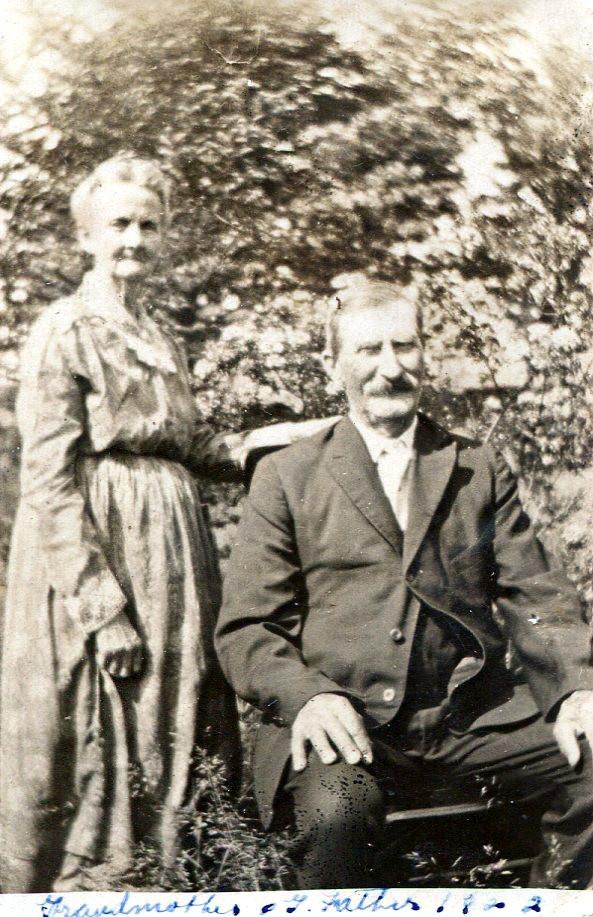 Lycenia (Strong) Mayo with husband Oscar sitting