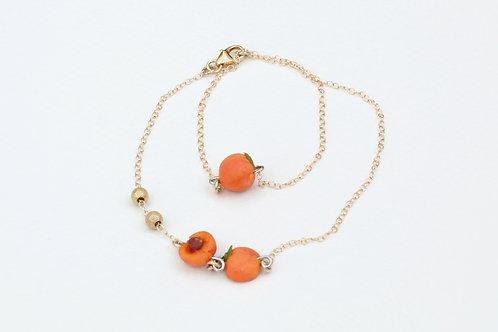 Peach goldfield bracelet