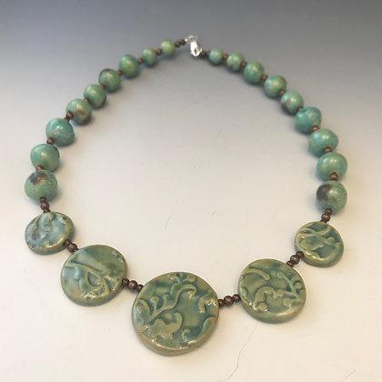 Brilliant green ama necklace