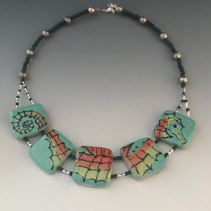 painted sea horse and necklace