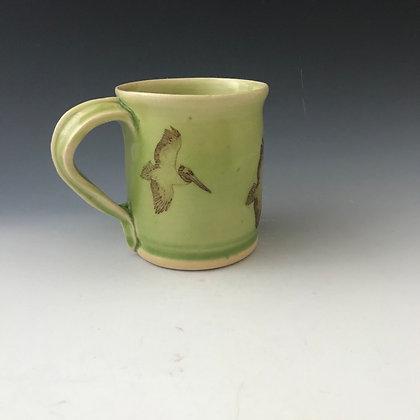 flying pelicans mug