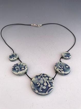 Blue embossed ceramic necklace